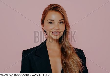 Charming Attractive Smiling Young Lady Standing In Positive Pose, Wearing Black Stylish Suit And Loo