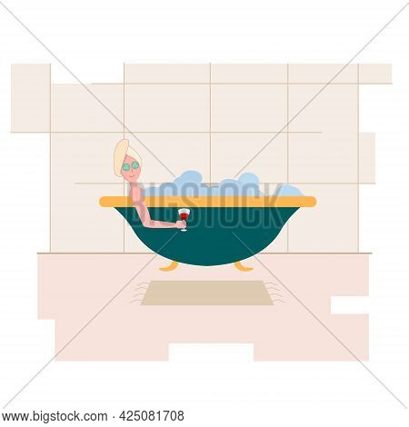 Woman In A Home Spa. Woman Rests After Work With A Glass Of Wine In The Bathroom. The Girl Takes A B