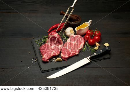 Fresh Raw Beef Or Pork Steaks On Stone Cutting Serving Board