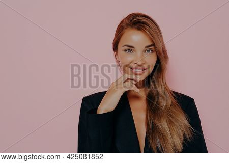 Attractive Office Lady With Long Loose Stright Hair And Healthy Skin. Smiling And Lightly Touches Ch