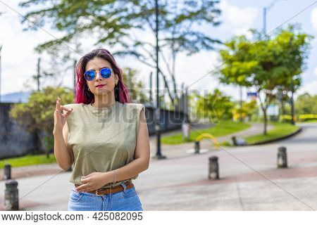 Young Latina Woman Standing Upright With A Firm Ok Gesture