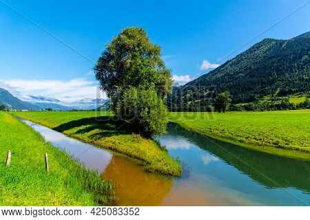 Broad Mountain Valley And Water Channel Near Zell Am See On Sunny Summer Day. Austrian Alps, Austria