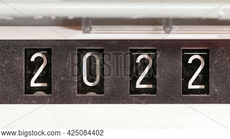 New year 2022 concept, mechanical counter turning from number 2021 to 2022