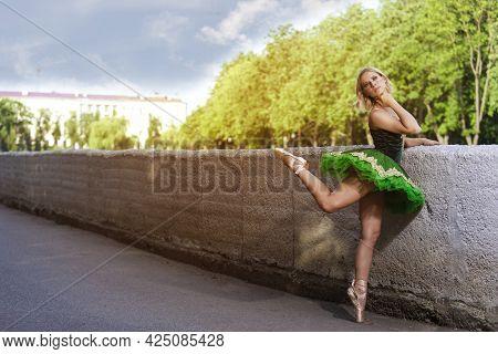 Dancing Concepts. Portrait Of Professional Caucasian Ballet Dancer In Green Tutu Dress Making Up Her