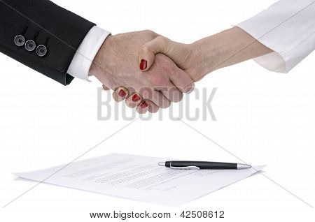 Man And Woman Shaking Hands Over A Contract