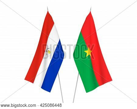 National Fabric Flags Of Burkina Faso And Paraguay Isolated On White Background. 3d Rendering Illust