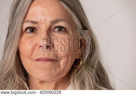 Happy senior woman portrait in a studio shoot