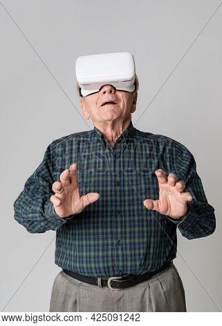 Senior man wearing virtual reality goggles mockup