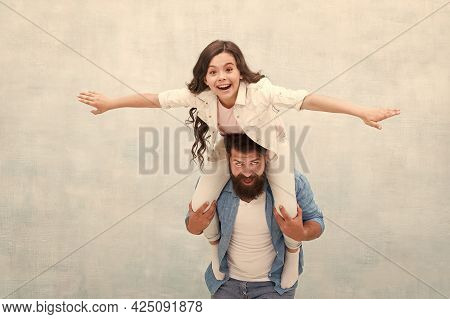Flight Of Imagination. Father Ride Daughter Child Pretending Flying. Happy Family Have Fun Together.