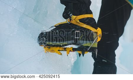 Close Up Shot Of An Ice Climbers Boot With Crampons, Sharp Metal Spikes That Protrude From The Botto