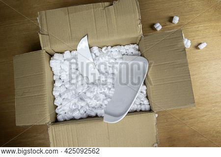 Broken Plate In Damaged Cardboard Box Top View, Damaged Home Delivery Unpacking Box