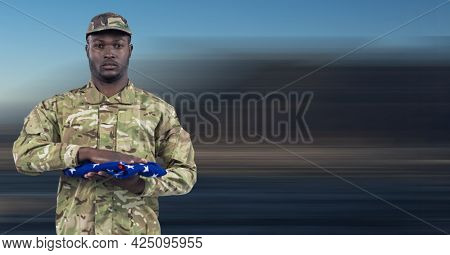 Composition of soldier with holding folded american flag. patriotism, independence and honour concept digitally generated image.