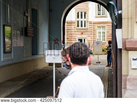Strasbourg, France - Jun 27, 2021: Pedestrians Near French Polling Station Sign Bureau De Vote. Vote