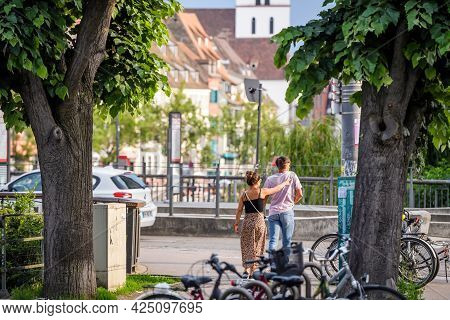 Strasbourg, France - June 7, 2021: Young Couple Walking On Empty Street In French City During Second