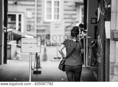Strasbourg, France - Jun 27, 2021: Rear View Of Woman Talking On Phone French Polling Station Sign B