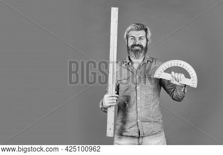 Ready For Engineering. Tool For Graphics. Mature Bearded Man Hold Protractor Ruler. Study At Home. E