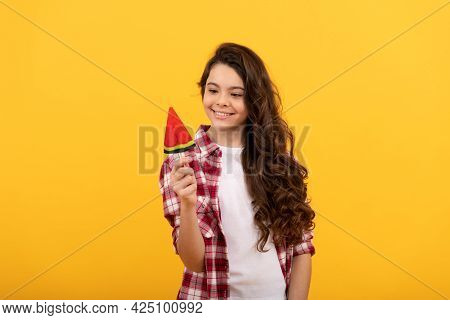 Happy Teen Girl With Long Curly Hair Hold Lollipop Caramel Candy On Yellow Background, Caramel Shop.