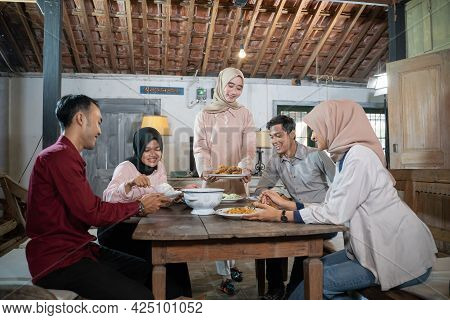 Girls In Hijabs And Some Men Gather And Eat Together In The Dining Room