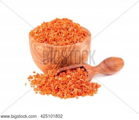 Dry Carrot In Olive Bowl And Scoop, Isolated On The White Background. Chopped Dried Carrot. And Herb