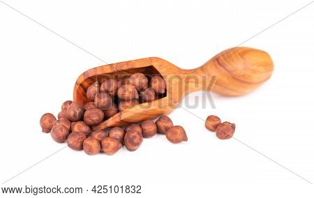 Pile Of Brown Chickpeas In Olive Scoop, Isolated On White Background. Brown Chickpea. Garbanzo, Beng