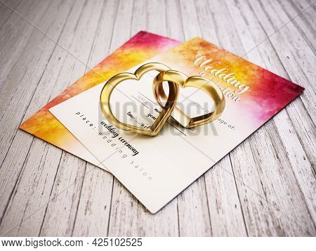 Two Attached Heart Shaped Rings Standing On Old Wooden Planks Next To The Wedding Invitation. 3d Ill