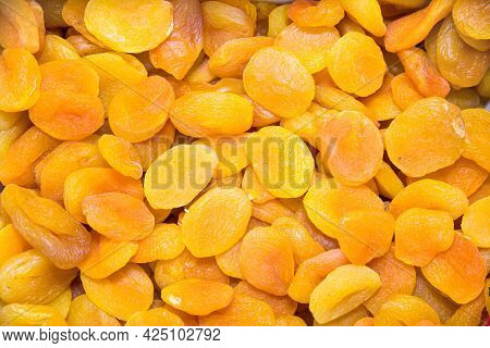 Dried Apricots Are Yellow In Color With A Bright Beautiful Pattern Of The Peel. Fruits Nuts Vegetabl