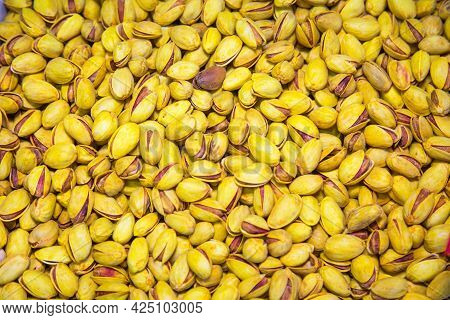 Pistachio Nuts Fried With Saffron Yellow Color With Open Shells. Fruits Nuts Vegetables Berries Usef