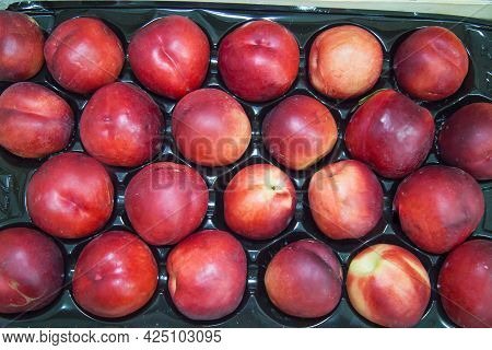 Cherry-colored Nectarine Fruits Laid Out In A Row. Fruits Nuts Vegetables Berries Useful Products Ag