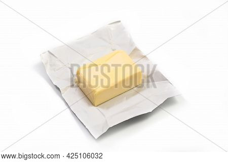Traditional Butter Block Unwrapped For Use As A Baking Ingredient Isolated On White Background. Clos