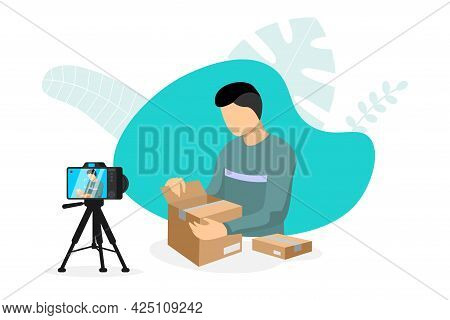 Blogger Making Video Parcel Unpacking Content On Camera With Tripod. Man Unboxing Cardboard Purchase
