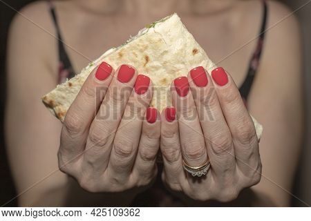 Woman Hand Picking Grilled Flatbread Filled With Ham And Slices
