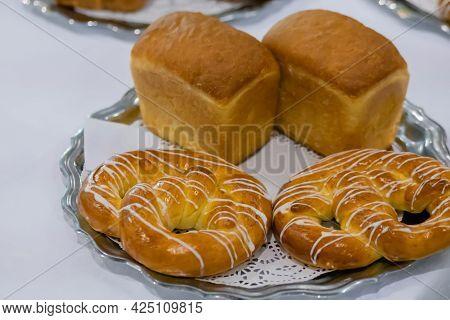 Freshly Baked Tradition Breads And Pretzels, Kringles On Plate At Cuisine Of Cafe, Restaurant Or Bak