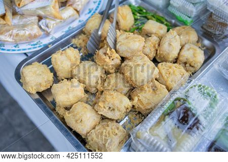 Fried Tahu Isi On A Serving Tray On The Table