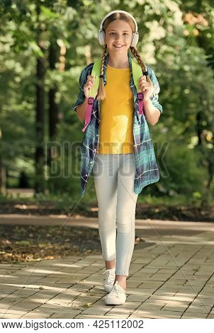 Time To Learn English. Happy Girl Wear Headphones Natural Outdoors. English Learning Courses. Listen