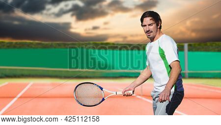 Composition of male tennis player holding tennis racket at tennis court. sport and competition concept digitally generated image.