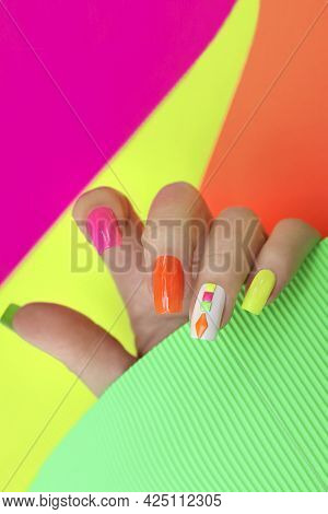 Bright Illuminated Multicolored Manicure On The Nails With Rhinestones.