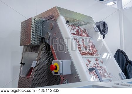 Plastic Details Moving On Conveyor Belt Of Automatic Injection Molding Machine At Factory, Exhibitio