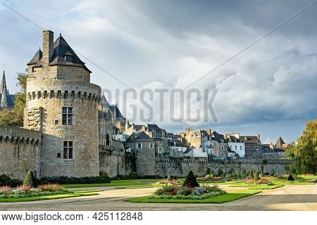 The medieval city of Vannes, Brittany. Formal gardens can be seen in the foreground.and walled ramparts enclose this old town in western France. IMAGE TAKEN FROM PUBLIC STREET.