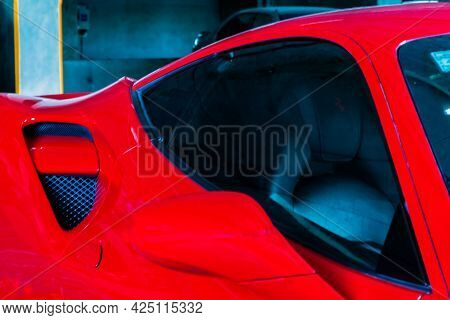 Bangkok, Thailand - 06 Jun 2021 : Close-up Of Side Mirror And Car Window Of Red Ferrari Car. Ferrari