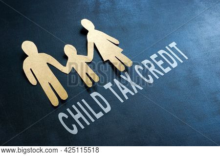 Paper Family And Words Child Tax Credit On The Blackboard.