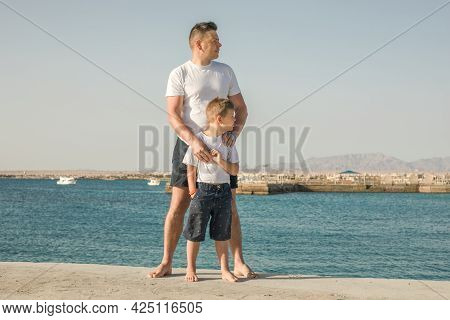 Father And  Son  Spending Time Together Sea Vacation. Young Man, Little Boy Walking Beach Fathers Da