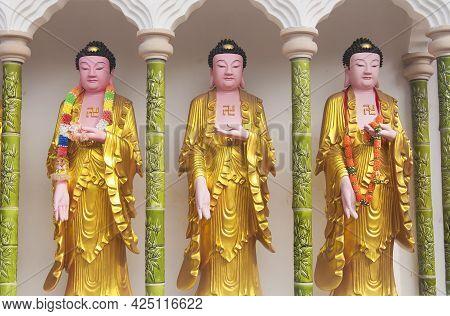 Three Buddha Statues At The Historic Kek Lok Si Buddhist Temple In Penang Malaysia.