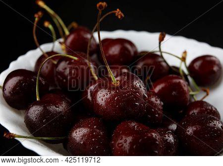Ripe Cherries Background. Ripe Juicy Cherries On A White Plate.