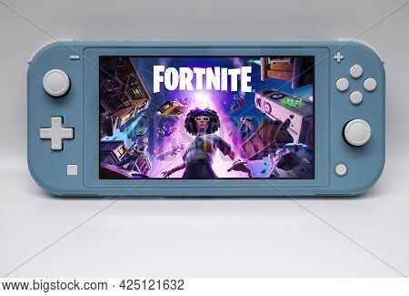 Málaga, Spain - June 23, 2021: View Of A Nintedo Switch Console With Fortnite Game On The Screen Wit