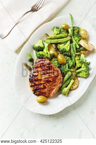 Grilled Turkey Breast With Oven Baked Potatoes And Broccoli. Bright  Wooden Background. Top View.