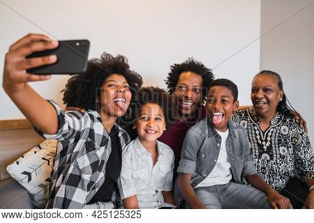 Multigenerational Family Taking Selfie With Phone At