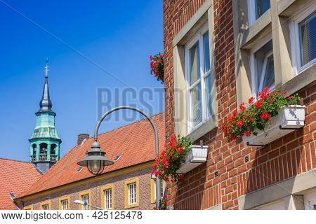 Red Flowers On A Facade Of A House In Meppen, Germany