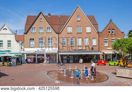 Meppen, Germany - June 16, 2021: People At The Fountain On The Market Square Of Meppen, Germany