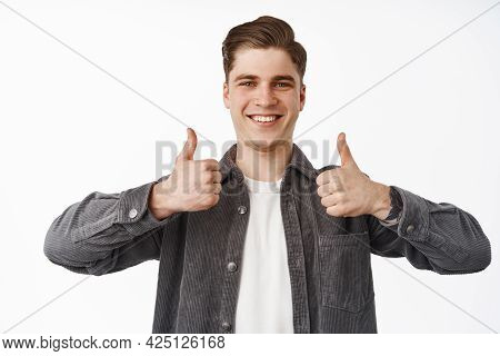 Close Up Portrait Of Happy Smiling Young Man, Boy Shows Thumbs Up, Nod Approvingly, Satisfied With C