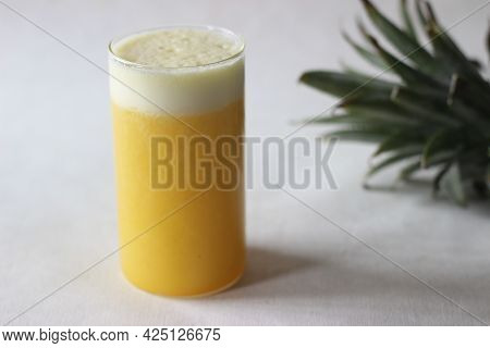 Chilled Pineapple Juice To Beat The Summer Heat. Home Made Juice Served In Long Glass Decorated With